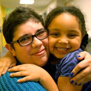 preschool program teacher with child