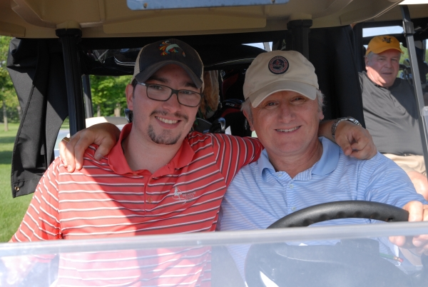 JJ and Jay Strausser in golf cart
